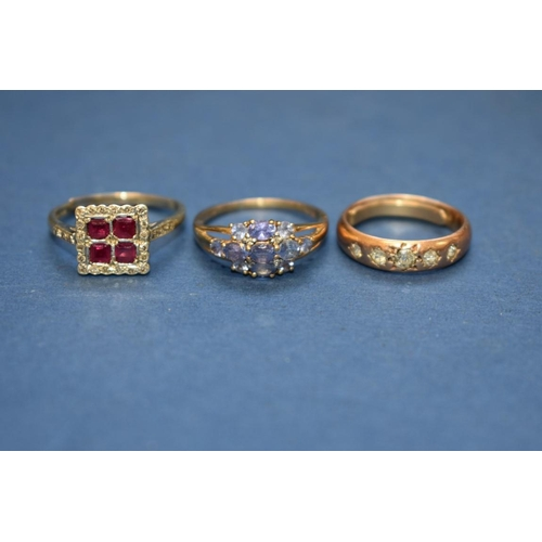 122 - <strong>Three gem set gold rings; </strong>together with an RAF sweetheart brooch; and a pair of sil...