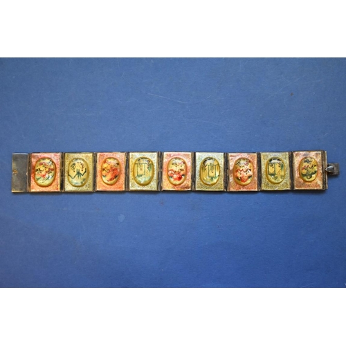 123 - <strong>An Oriental mother of pearl bracelet, </strong>consisting of seven painted scenic panels....