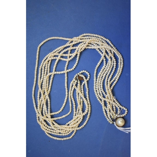 124 - <strong>An eight strand pearl choker,</strong>having base metal and pearl clasp, 45cm....