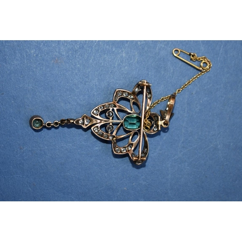 125 - <strong>An Edwardian diamond and synthetic emerald pendant, </strong>having hinged brooch fitting, s...