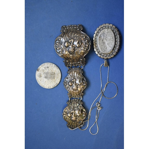 131 - <strong>A silver locket;</strong> together with two other items....