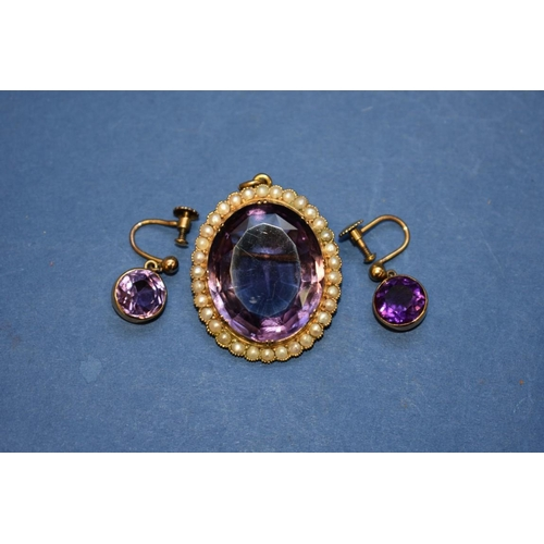 132 - <strong>A large amethyst and pearl </strong><strong>oval </strong><strong>pendant</strong>, having b...