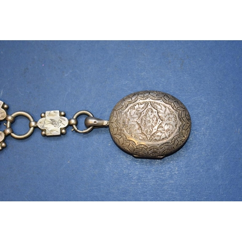 133 - <strong>A Victorian chased silver locket and collar, </strong><em>by  A.B.</em>, Birmingham 1881, 82...