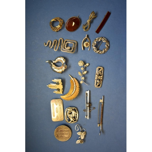135 - <strong>A collection of silver brooches,</strong> to include a Caithness example; together with vari...