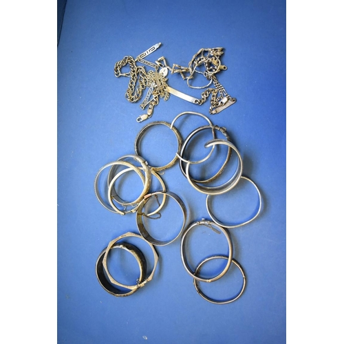 140 - <strong>A collection of silver bangles and bracelets</strong>, 316g....