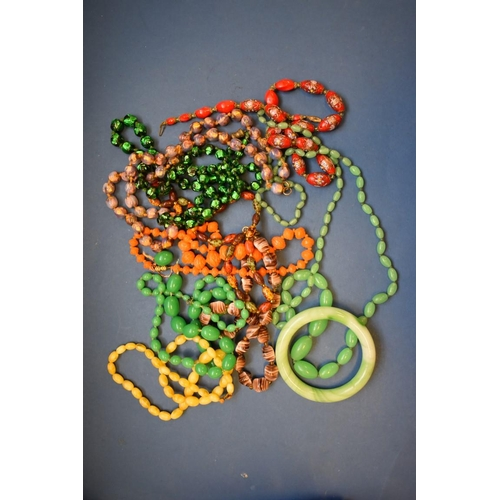145 - <strong>A jade bangle;</strong> together with two jade bead necklaces; and other glass beaded neckla...