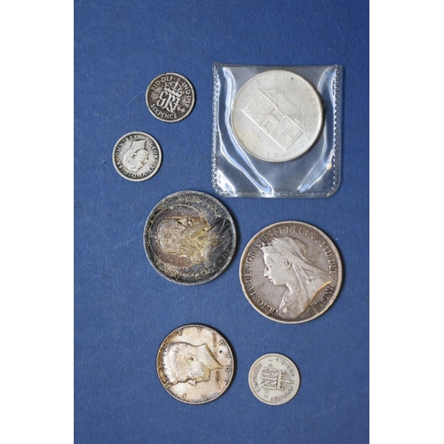 154 - <strong>A cased Maria Theresa Thaler</strong>; together with a Victoria 1893 crown and other coins...