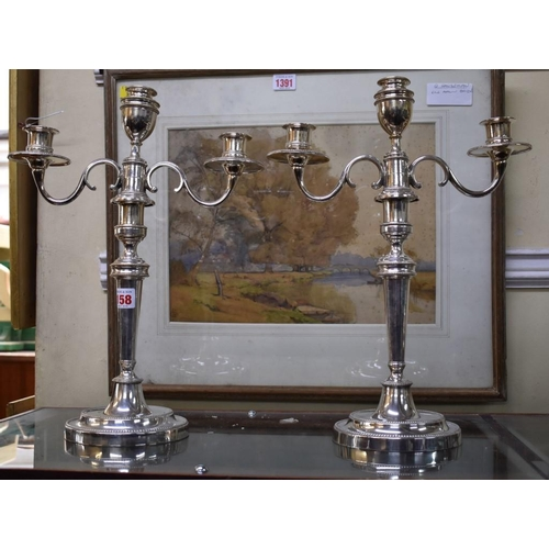 158 - <strong>A pair of Old Sheffield plate twin branch candelabra, </strong>40cm....