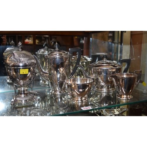163 - <strong>An Art Deco style EPNS four piece tea set, </strong>by <em>Mappin &amp; Webb;</em> and an EP...