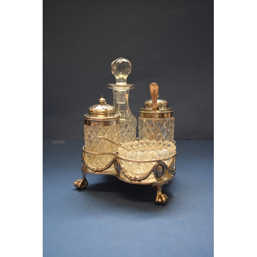 18 - <strong>A Victorian silver and cut glass four piece cruet stand,</strong> <em>by Martin, Hall &amp; ...