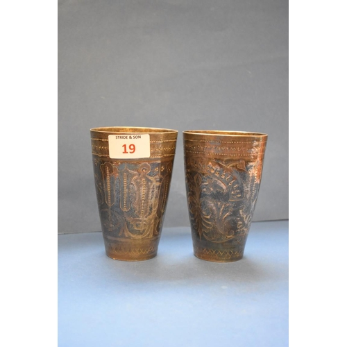 19 - <strong>A pair of Eastern metal beakers, </strong>12.5cm....