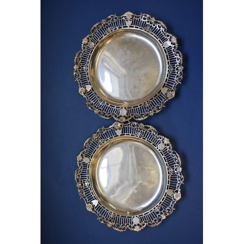 2 - <strong>A good pair of Edwardian pierced silver dishes,</strong> <em>by Mappin &amp; Webb, </em>Shef...