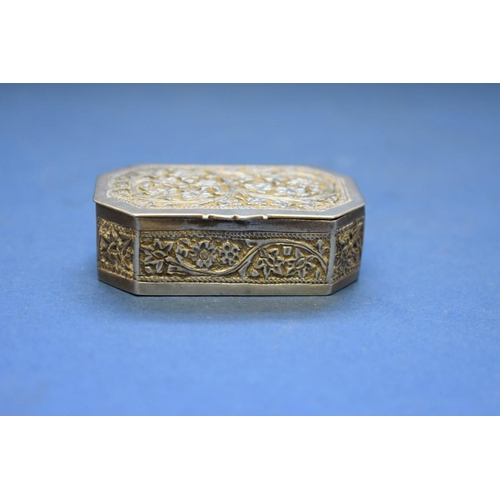 36 - <strong>An eastern metal casket,</strong> of canted rectangular form, with hinged cover, 6cm wide, 4...