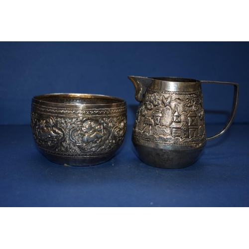 49 - <strong>An Indian white metal creamer</strong>; together with a similar sugar bowl....
