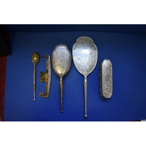 50 - <strong>A</strong><strong>silver</strong><strong>four piece dressing table set, </strong><em>by Ch...