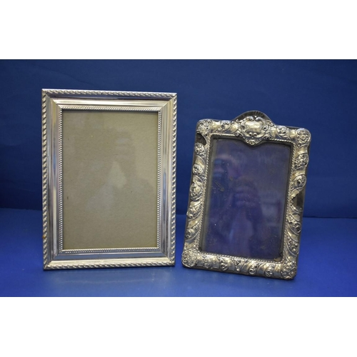52 - <strong>Three modern silver photograph frames;</strong> together with two silver plated examples....