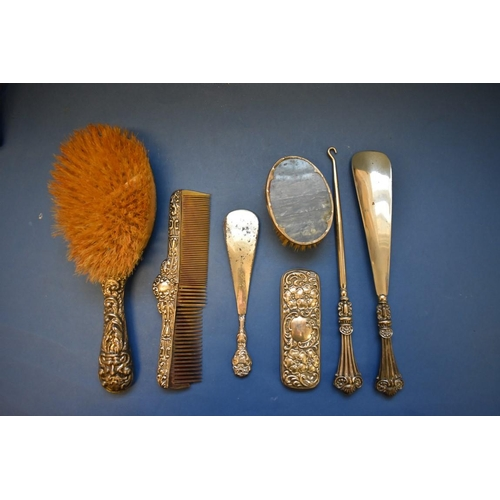 57 - <strong>A selection of silver ladies dressing accessories.</strong>...