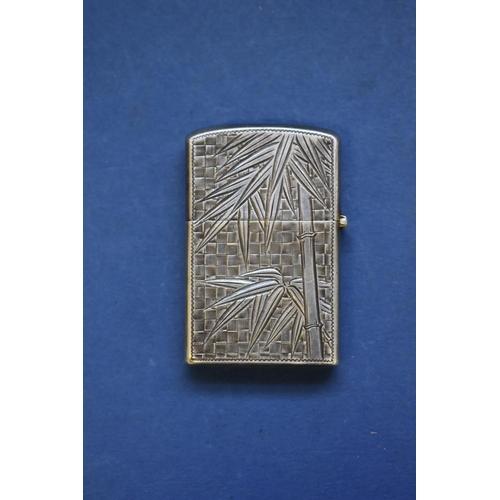 59 - <strong>A sterling silver flint lighter, </strong>decorated bamboo....