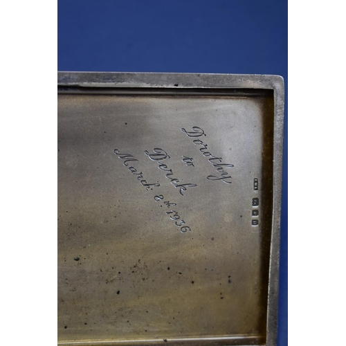 60 - <strong>An engine turned silver cigarette case, </strong>167g;together with a sterling silver niell...