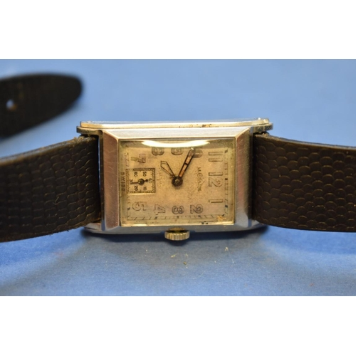 66 - <strong>A 1940s Jaeger Le Coultre gentlemans tank watch, </strong>case number 202559 on black leathe...