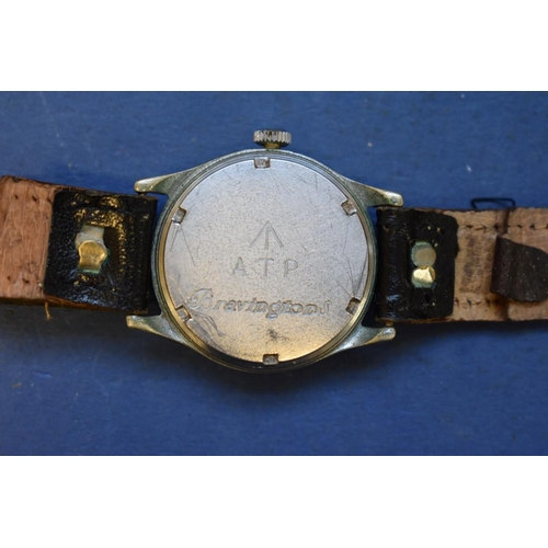 68 - <strong>A World War ll era ATP military wristwatch, </strong>by Bravington, on leather strap....