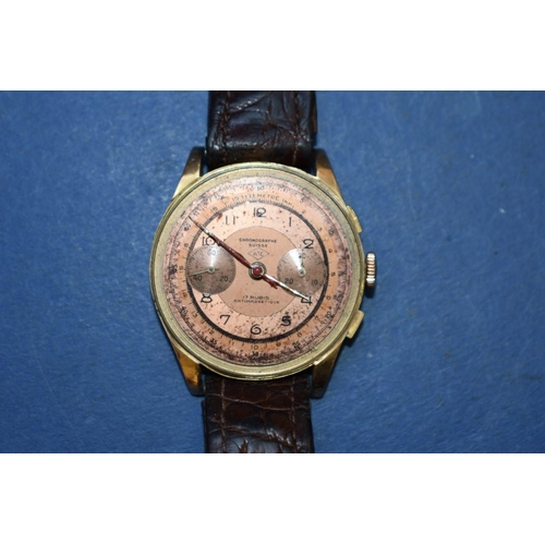 69 - <strong>A vintage ATC Chronograph Suisse 18k gold wristwatch,</strong> on crocodile strap....