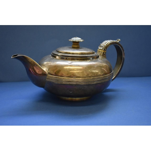 7 - <strong>A Georgian silver squat tea pot,&nbsp;</strong>having ivory insulators, unidentifiable marks...