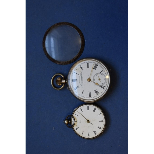 76 - <strong>An .800 open faced pocket watch,</strong> having enamel dial and Roman numerals; together wi...