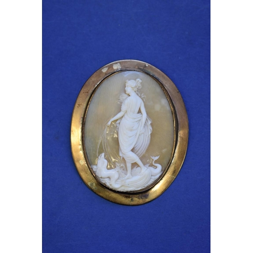 85 - <strong>A Victorian carved shell cameo brooch, </strong>depicting&nbsp;Galatea leading dolphins, in ...