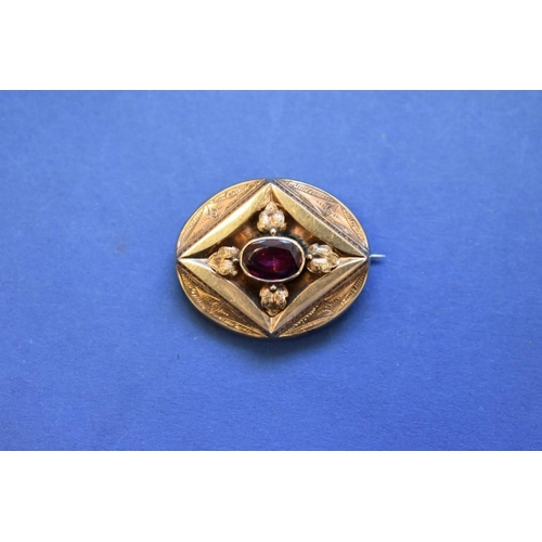 86 - <strong>A Victorian unmarked gold memento mori brooch,&nbsp;</strong>set oval amethyst with glass ha...