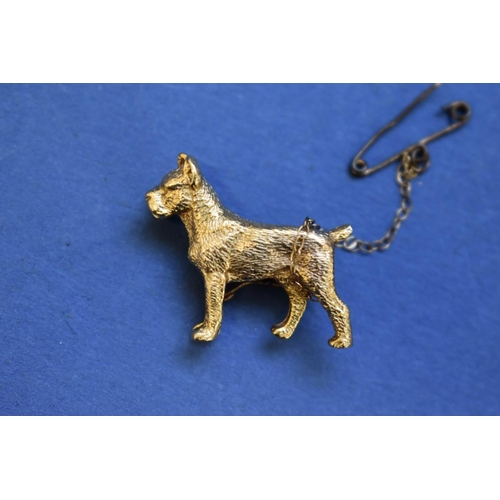90 - <strong>A 9ct gold 'boxer dog' brooch,</strong> 2.5cm, 6.6g....
