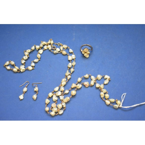 98 - <strong>A 9ct gold and baroque pearl necklace</strong>, 110cm; together with a matching ring and ear...