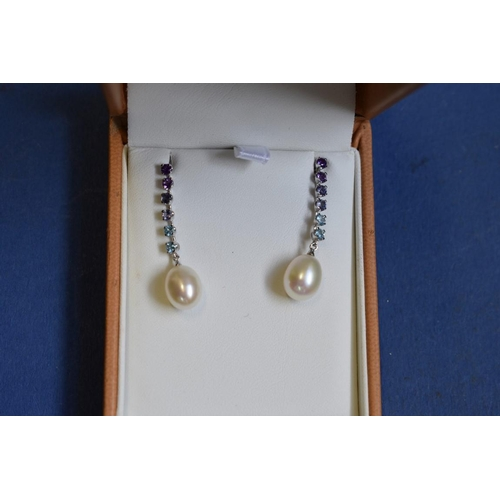 99 - <strong>A pair of 9ct gold pearl pendant earrings,</strong> the drops set amethyst and aquamarine.<b...