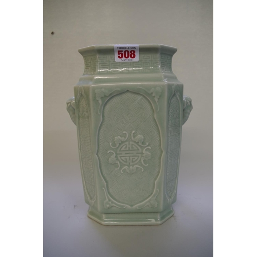 508 - <strong>A Chinese celadon twin handled vase, </strong>incised with bats and geometric decoration, 26...