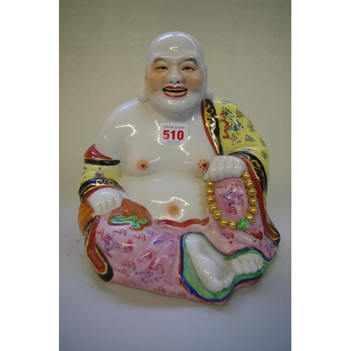 510 - <strong>A Chinese famille rose buddha,</strong> 24cm high....