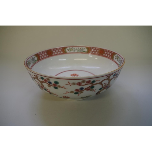 513 - <strong>A famille rose bowl,&nbsp;</strong>painted and gilded with flowering prunus trees, 23cm diam...