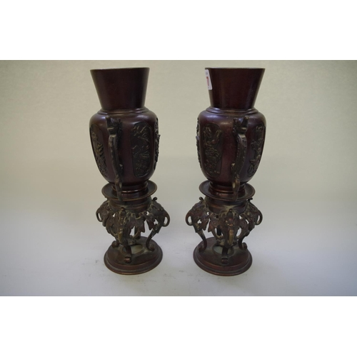 517 - <strong>A pair of Chinese bronze twin handled vases, </strong><em>19th century,</em> 25.5cm high....