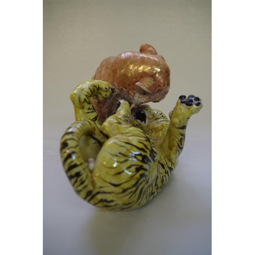 524 - <strong>A Japanese porcelain figure group of two fighting tigers,</strong>&nbsp;<em>probably Meiji p...