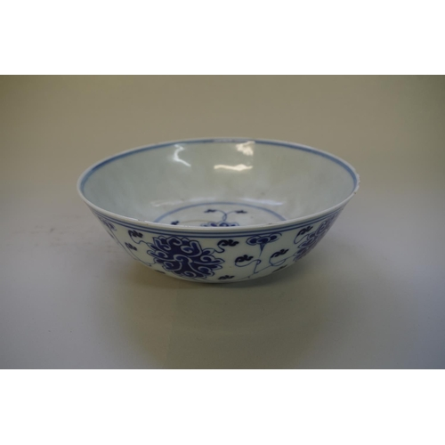 526 - <strong>A Chinese blue and white bowl</strong>, <em>four character mark,</em> painted with stylized ...