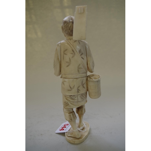 544 - <strong>A Japanese carved ivory&nbsp;</strong><strong>sectional&nbsp;</strong><strong>okimono of a g...