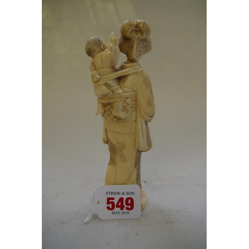 549 - <strong>A Japanese carved ivory okimono of a mother and child</strong>,&nbsp;<em>Meiji period,&nbsp;...