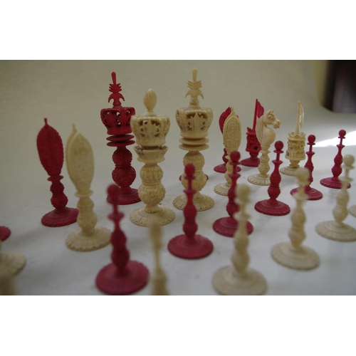 551 - <strong>A Chinese export carved ivory chess set,&nbsp;</strong><em>19th century,&nbsp;</em>red stain...
