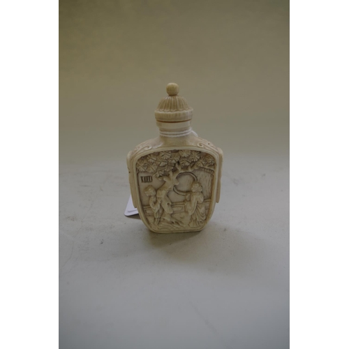 553 - <strong>A Chinese carved ivory snuff bottle and stopper,</strong> seal mark, 7.5cm high....