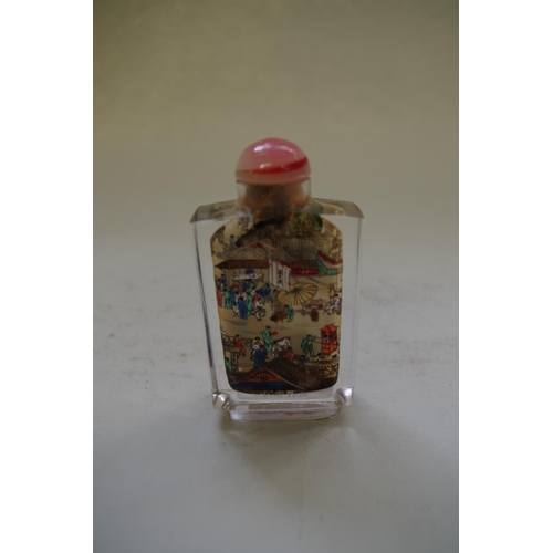 554 - <strong>A Chinese internally painted rock crystal snuff bottle and stopper,</strong> 8.2cm high....