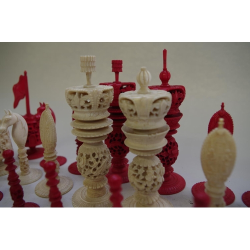 555 - <strong>A Chinese export carved ivory chess set</strong>, <em>19th century</em>, red stained and nat...