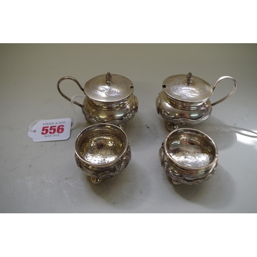 556 - <strong>A Chinese silver four piece cruet set,</strong> <em>by CS, late 19th century, </em>engraved ...