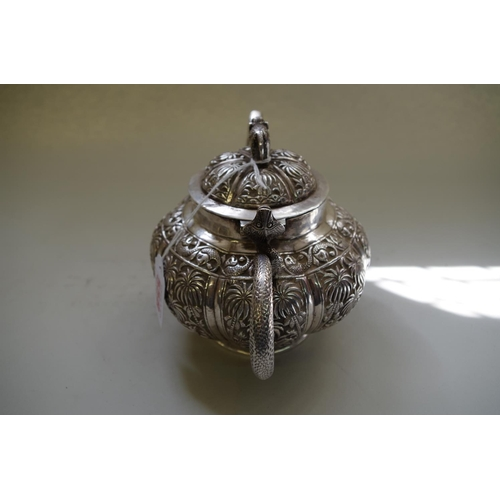 558 - <strong>An Indian silver teapot,</strong> <em>probably Lucknow, late 19th century, </em>of lobed for...