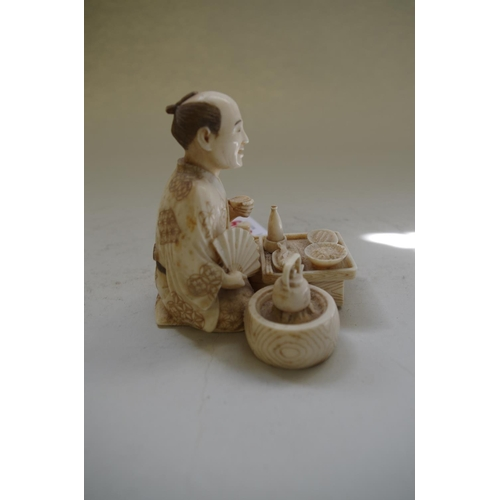 559 - <strong>A good Japanese carved ivory okimono,</strong>&nbsp;<em>Meiji period,&nbsp;</em>signed on ta...