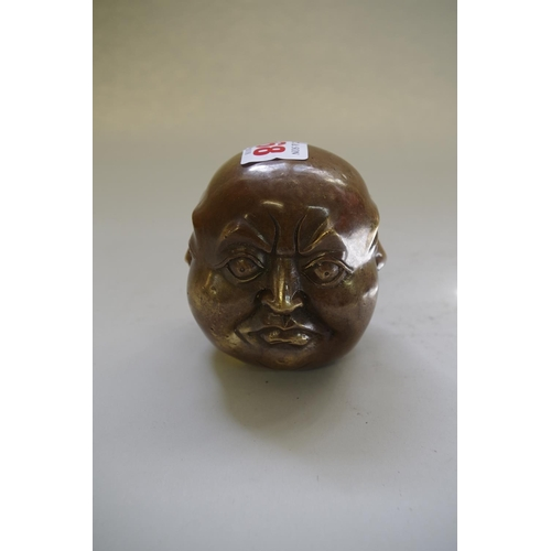 568 - <strong>A Chinese bronze head of a buddha with four faces,</strong> 8cm high....