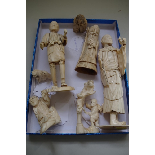581 - <strong>A mixed group of Oriental carved ivory, bone and vegetable ivory figures.</strong> (7)...